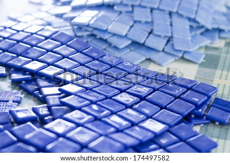 Manufacturing Blue mosaic tiles - stock photo