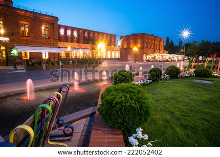 Manufaktura - the biggest shopping center in Europe. Shopping mall at night. July 2014 - stock photo
