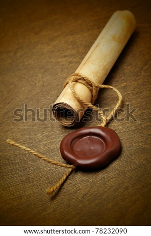 Manuscript with wax seal on a wooden table - stock photo