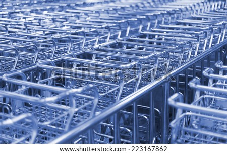 Many airport luggage carts in a row. - stock photo