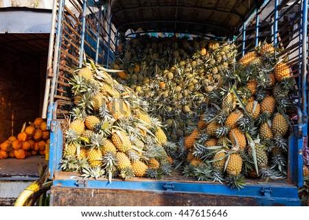 many ananas, pineapple in car - stock photo