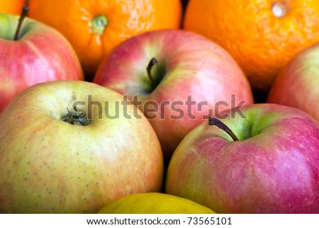 many apples and oranges close-up macro background