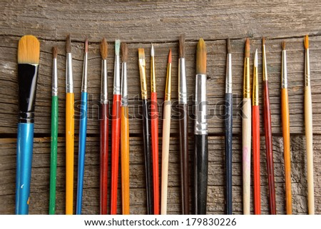Many artist brushes for use with any media like acrylic, watercolor and others - stock photo