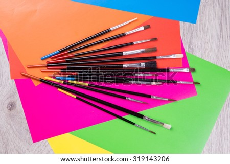 Many artist brushes for use with any media like acrylic, watercolor and others.