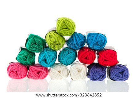 Many balls of colorful wool isolated over white background - stock photo