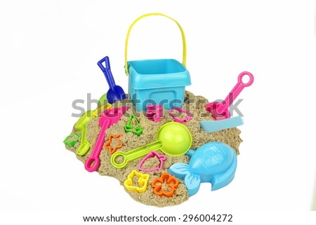 Many Beach Toys On The Kinetic Sand Heap Isolated On White Background. Childrens Creativity Or Game Concept. This Sand Can Be Used For Indoor Table Game. - stock photo