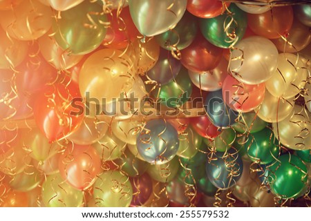 Many beautiful air colorful balloons on our holiday - stock photo