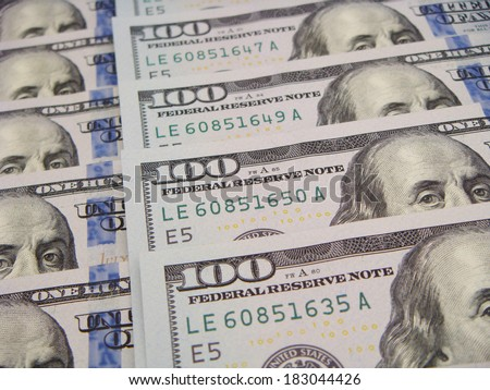 Many Ben Franklins Looking Out In Orderly Fashion. US Hundreds Arranged Neatly. - stock photo