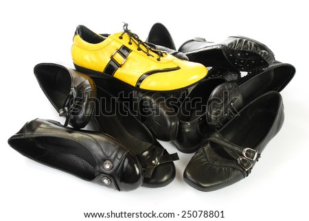 many black shoes and from above one yellow