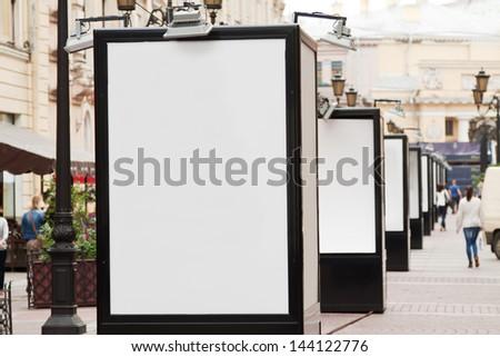 many blank billboards at city street - stock photo