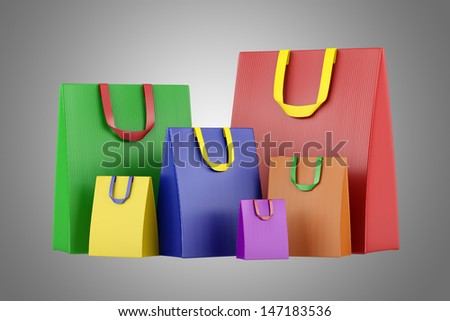 many blank color shopping bags isolated on gray background - stock photo