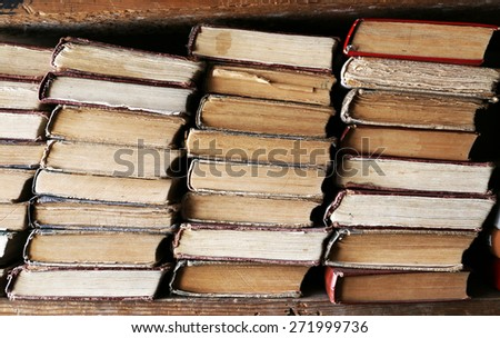 Many books on bookshelf in library - stock photo