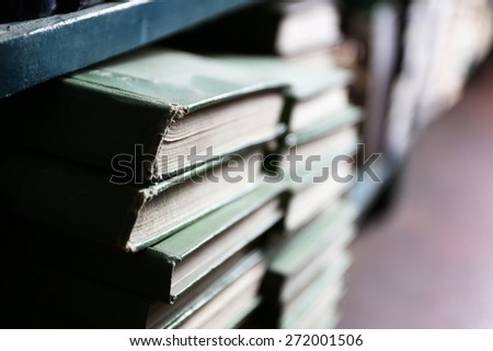 Many books on bookshelf in library, closeup - stock photo