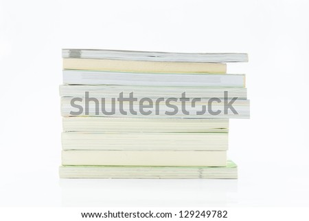 Many books on white backgrounds.