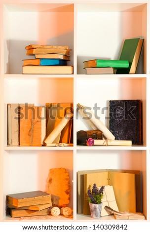 Many books on white  shelves - stock photo