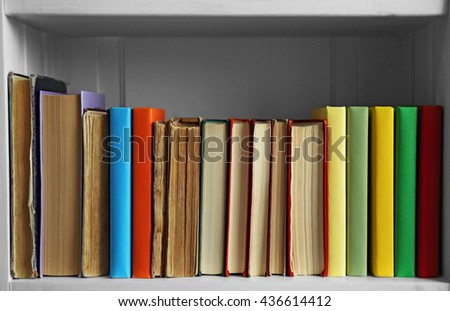 Many books on wooden shelf