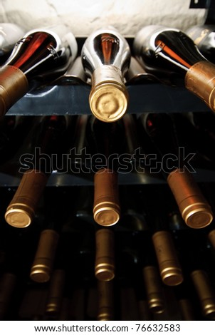 many bottles of wine in a wine cellar - stock photo