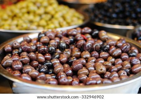 Many bowls of olives at the farmer's market  - stock photo