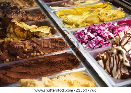 Many boxes of ice cream gelato in a shop - stock photo