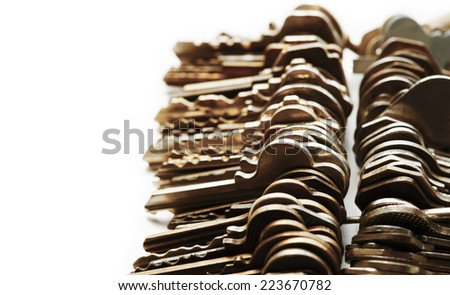 Many brass and chrome old keys. Security and encryption, concept image. Shallow depth of field. - stock photo