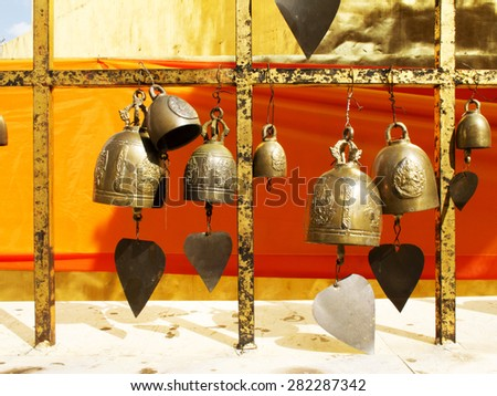 Many brass bell in Thai temple - stock photo