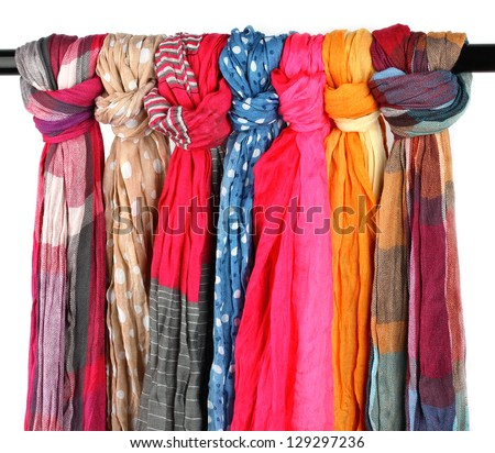 Many bright female scarfs isolated on white - stock photo