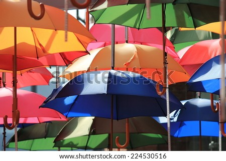 many bright vivid umbrellas hanging in street London - stock photo