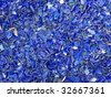 many broken pieces of glass in blue - stock photo