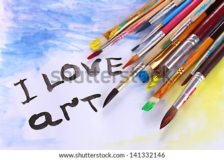 Many brush in paint and picture close-up - stock photo