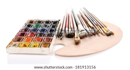 Many brushes on wooden palette, isolated on white - stock photo
