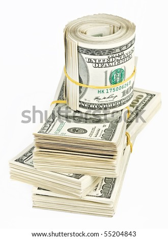 Many  bundle and roll of US 100 dollars bank notes isolated on white background - stock photo