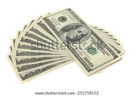 Many bundle of US 100 dollars bank notes isolated on white background