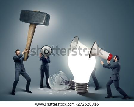 Many businessmen with megaphones - stock photo
