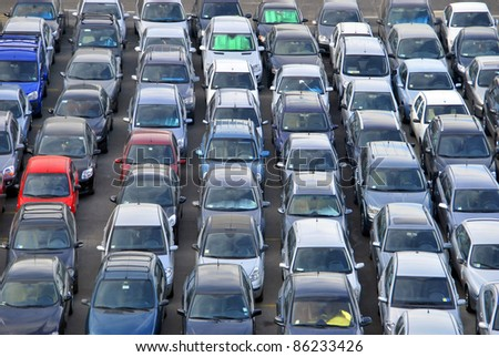 Many cars parked and distributed in rows. - stock photo
