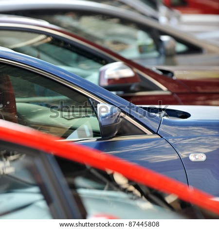 many cars parked in a row - stock photo