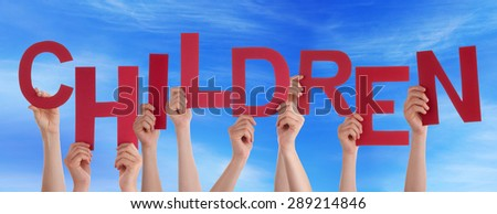 Many Caucasian People And Hands Holding Red Letters Or Characters Building The English Word Children On Blue Sky - stock photo