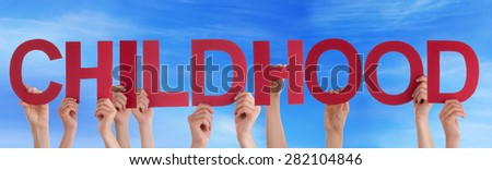 Many Caucasian People And Hands Holding Red Straight Letters Or Characters Building The English Word Childhood On Blue Sky - stock photo
