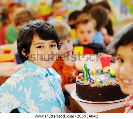 Many children having fun at birthday party - stock photo