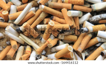 many cigarette butts for backgrounds - stock photo
