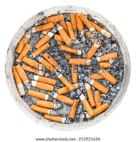 many cigarette butts in plastic ashpot isolated on white background - stock photo