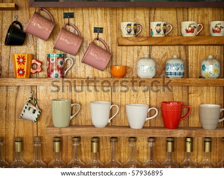 many coffee cup on wood shelf background - stock photo