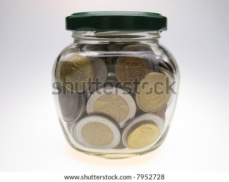 many coin money in glass jar, close up - stock photo