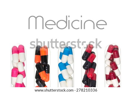 Many color of drug or pill or vitamin capsule in test tube isolated on white background. Background about medical or clinic or pharmacy or hospital story.