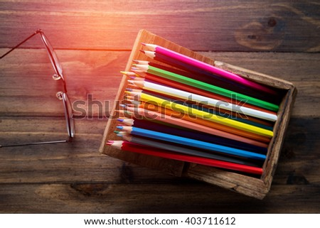 many color pencil in the box on wooden table  - stock photo