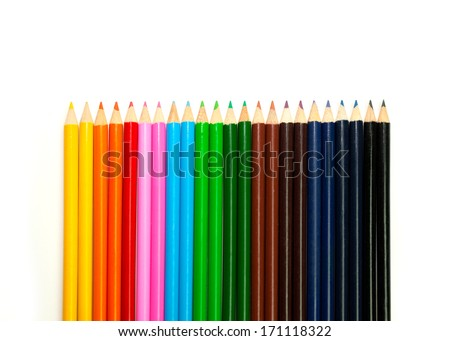 many colored pencils arranged in tonal scale - stock photo