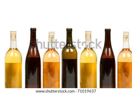 Many Colorful Assorted Bottles of Wine Isolated on a White Background