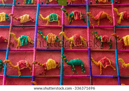 Many colorful hand made toy camels made of silk cloth for sale - stock photo