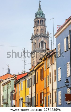 Many colorful houses built in a row in Parma, Italy. - stock photo