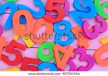 Many colorful numbers on purple wooden table