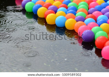 Many colorful plastic Balls floating in water.